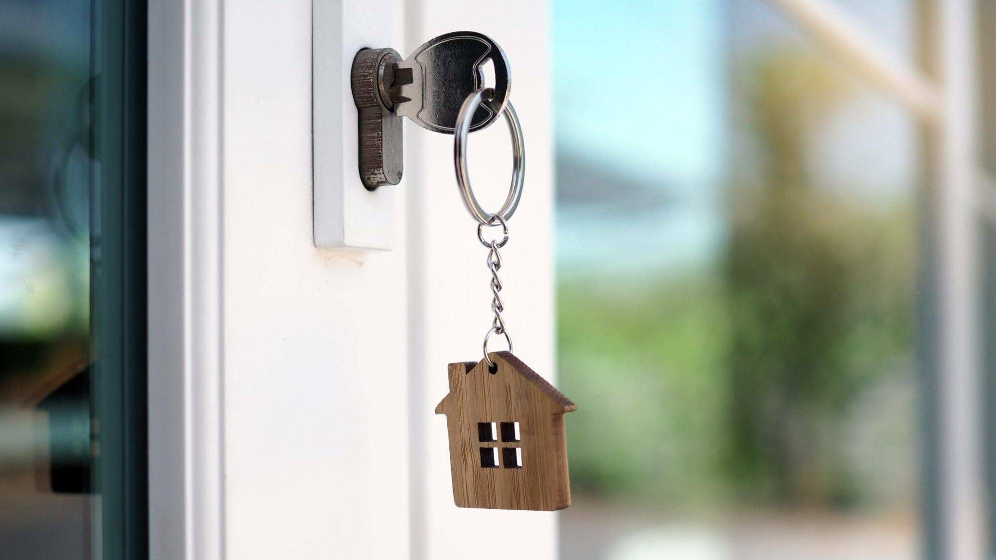 The house key for unlocking a new house is plugged into the door, Rewire, homebuyers, PBS