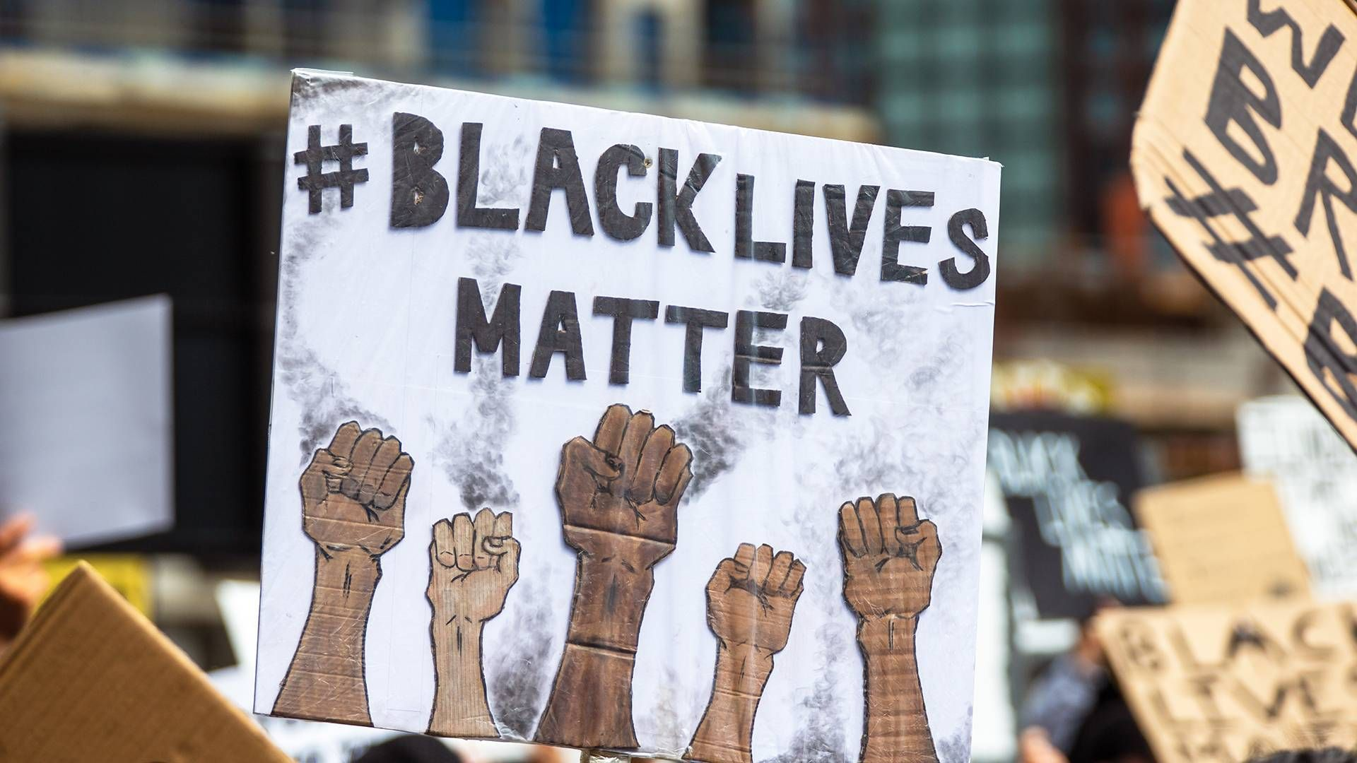 a sign at a Black Lives Matter protest. Rewire, PBS, our future, emergency powers, protests