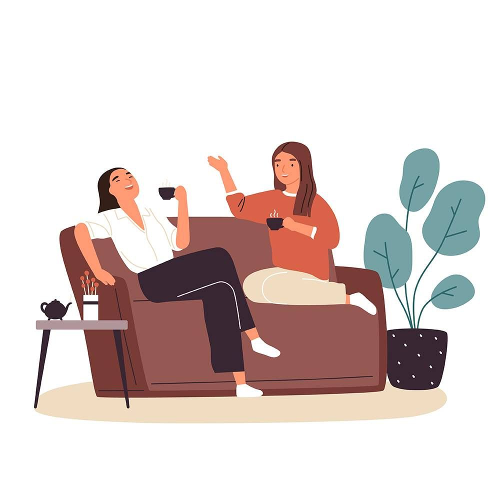 Smiling woman friends drinking tea at home. PBS, rewire, love, platonic marriages, marriage