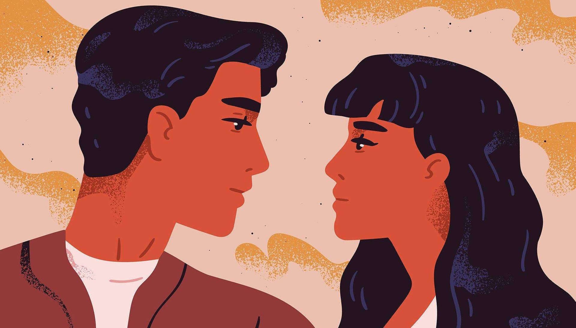 Portrait of young man and woman looking at each other.