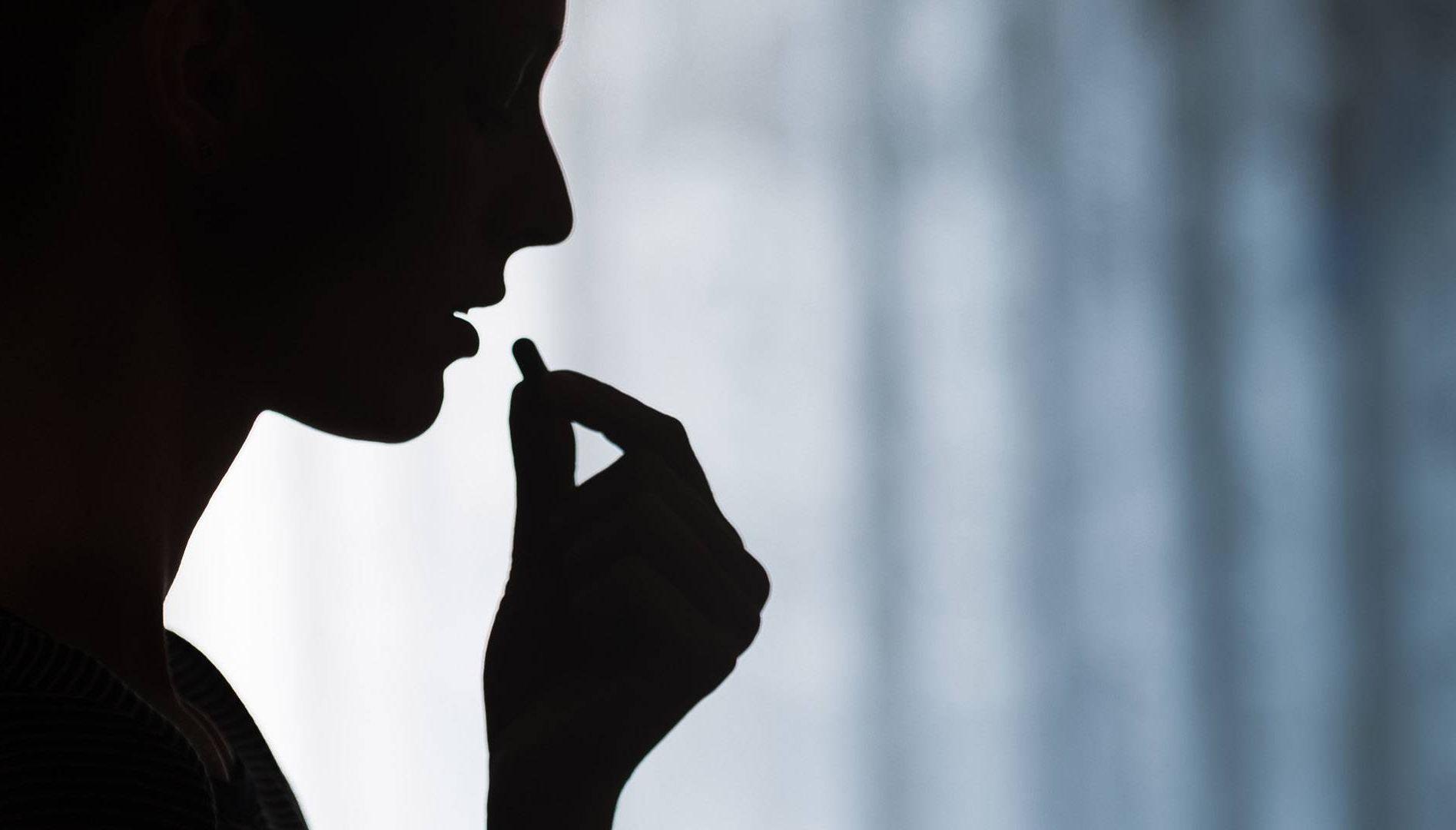woman taking pill. REWIRE PBS love heartbreak